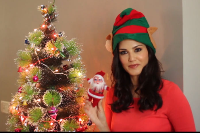 sunny leone dressed as Santa Claus on christmas